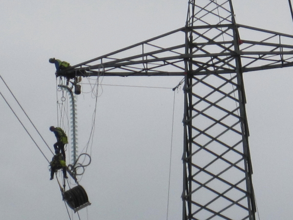 Men Working on Pylon near Brandon