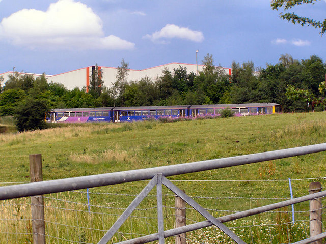 Train Passing Stakehill Industrial Estate