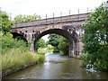 SJ8965 : Railway bridge over Macclesfield Canal by David Martin