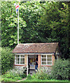 TL4340 : Heydon: flag-waving bus shelter by John Sutton