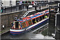 Jenny Wren Canal Cruises barge makes it way towards Camden Lock on a drizzly day.