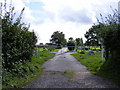 TM3977 : Halesworth Cemetery entrance by Adrian Cable