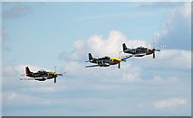 TL4646 : Three P-51 Mustangs in close formation over Duxford by Matthew Bristow