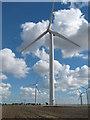 TQ9721 : Wind Turbines and the Little Cheyne Court Farm by David Anstiss