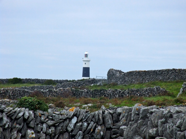 Lighthouse amongst the drystone walls of Inis Oírr
