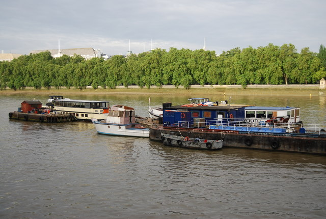 A selection of boats moored on the River Thames