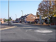 SD5408 : Mini roundabout and shops at Shevington by Raymond Knapman