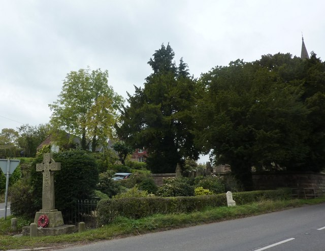 Memorial cross, milestone and churchyard