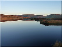 SH8514 : Reflections in Llyn Foeldinas by Richard Law