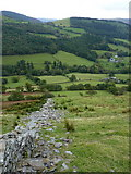 SH8615 : Downhill beside the dry stone wall by Richard Law