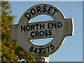 ST8427 : Motcombe: detail of North End Cross signpost by Chris Downer
