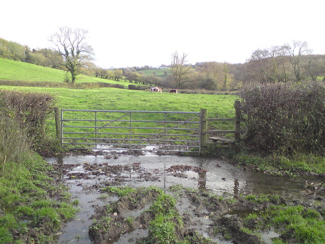 Muddy footpath and stile