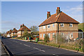 Dist:0.6km<br/>A row of 6 semi detached houses in New Road.  Behind is the embankment of Queen Mary Reservoir.