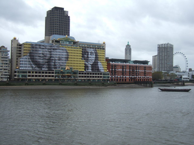 Giant faces looking over the River Thames, London