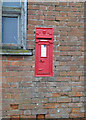 TM3747 : Victorian postbox set into the wall of a barn by Adrian S Pye
