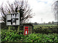 TG3103 : Parish notice board, GR postbox and pylons by Adrian S Pye