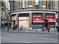 The store is still trading following damage caused during the student march on 9th December 2010.