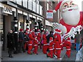 SO1091 : Santas outside Bear Lanes, Broad Street by Penny Mayes