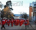SO1091 : High Street full of Santas by Penny Mayes