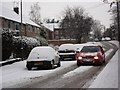 SP2972 : Car moving slowly along Whateleys Drive in the snow by John Brightley
