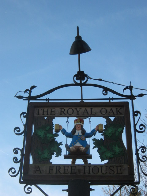 A close-up of The Royal Oak Pub Sign