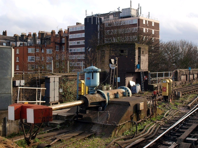 Hydraulic buffers and war-time pill box at Putney Underground Station in Fulham