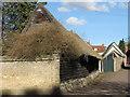 TL5646 : Linton: sixteenth-century barn by John Sutton