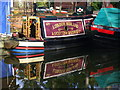 Dist:0.3km<br/>An unlikely combination of Railway Company name and a narrowboat on the Basingstoke Canal. Perhaps the boat once belonged to the LMS?