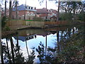Dist:0.4km<br/>The canal here passes between contrasting residential areas of Woking.