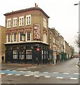 Formerly the Dolphin, the former pub stands at the crossroads of Cable Street (left) and Cannon Street Road.