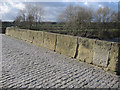 SJ3845 : Weathered parapet on Bangor-is-y-coed bridge by John S Turner