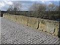 SJ3845 : Weathered parapet on Bangor-is-y-coed bridge by John S Turner