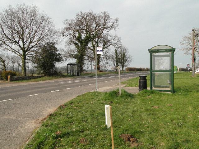 Bus stop shelters on the A140 at Alby