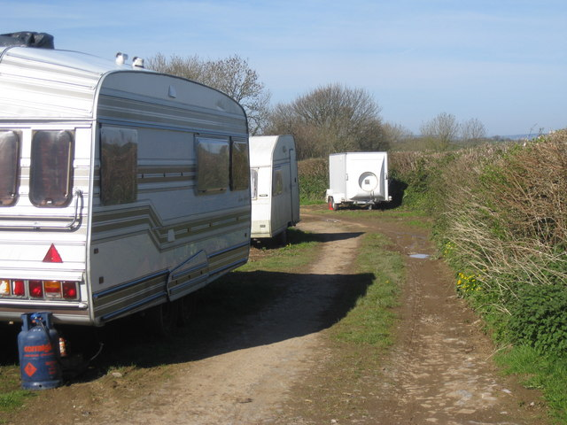 Travellers' encampment along footpath