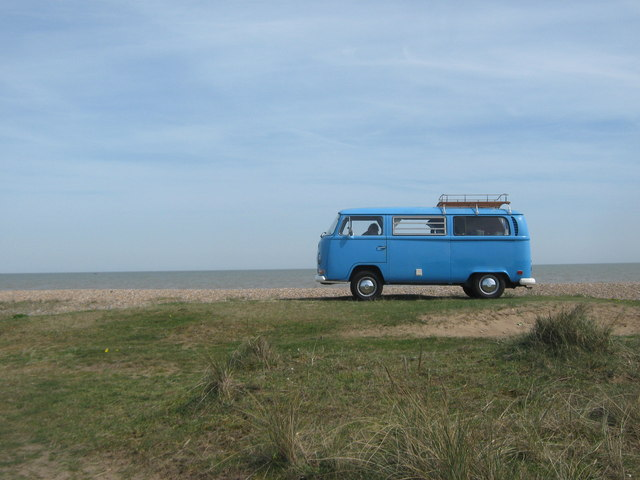 Blue VW Camper Van on the sea wall