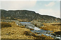 SH8437 : The outflow from Llyn Arenig Fawr by Nigel Brown