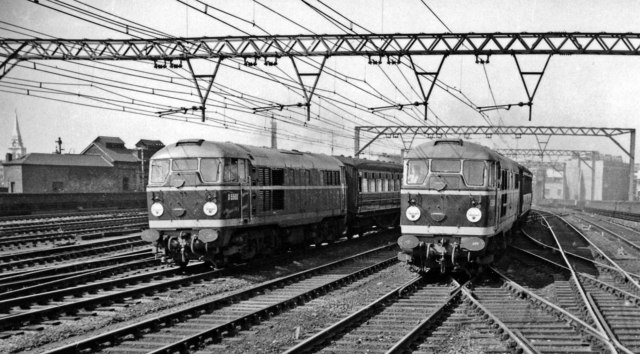 Two Diesel-hauled expresses racing up from Liverpool Street at Bethnal Green