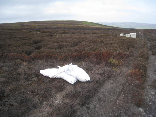 Bags of grouse grit and feeders