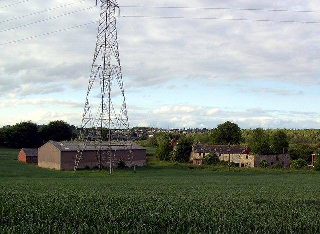 Electricity pylon dwarfs Fryston Hall Farm