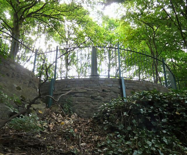 Behind Godley Hill War Memorial