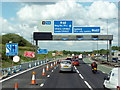 SJ7398 : Approaching junction 12 on the M62 east bound by Ian S