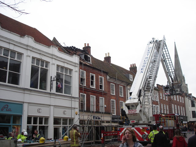 "Chichester - aftermath of fire above ""Fat Face"""
