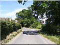 TG0329 : Entering Hindolveston on Foulsham Road by Adrian Cable
