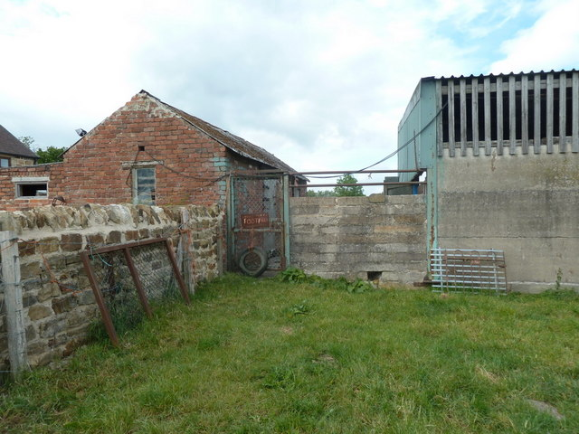 Footpath gate between buildings at Danesmoor Farm