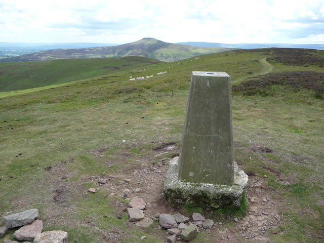 Trig point on Crug Mawr with the Sugar Loaf to the south