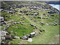 SM7227 : Hut Circles, St David's Head by Chris Andrews