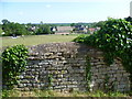 TF0904 : Churchyard wall by Marathon