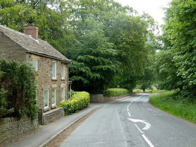 Road through Hollins towards Old Brampton
