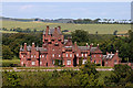 Dist:0.2km<br/>This red sandstone Scots Baronial castle was completed in 1851.