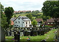 SK4680 : Churchyard and houses beyond, Killamarsh by Andrew Hill